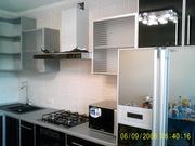 Шикарная кухонная мебель с встроенной техникой,  мойкой и смесителем